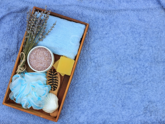 Natural herbal spa cosmetics with lavender extract - soap, salt, towel, massage brush, washcloth