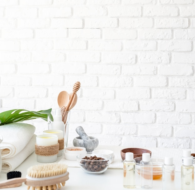 Natural homemade cosmetics on white table with copy space