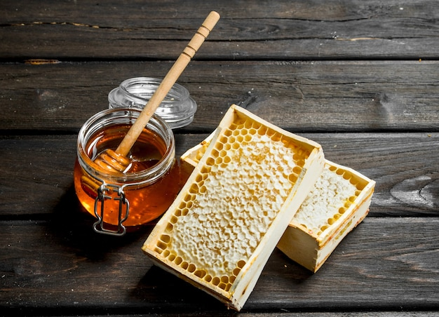 Natural honey in honeycombs. on a wooden.