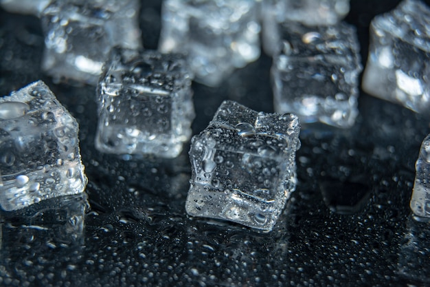 Natural ice cubes on black background, isolated on black. pieces of ice on a black background, ice, cold
