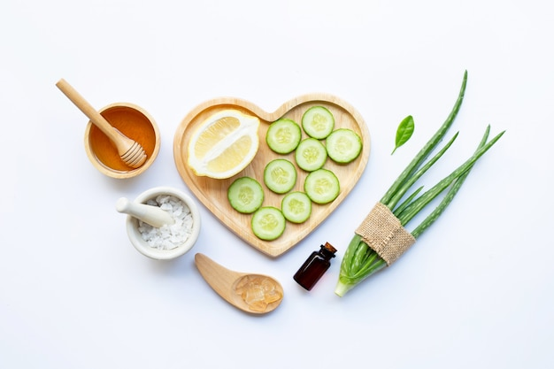 Natural ingredients for homemade skin care on white.