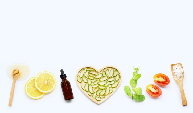 Natural ingredients for homemade skin care on white
