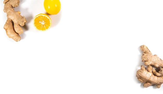 Natural ingredients. lemon and ginger roots on a white background, top view, flat lay. copy space.