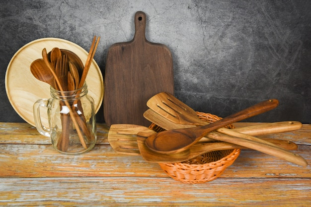 Natural kitchen tools wood products / kitchen utensils background with spoon fork chopsticks plate cutting board object utensil wooden concept