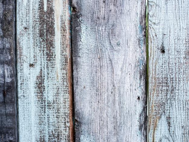 創造性のための自然な結び目の灰色の風化した木の板のテクスチャの背景