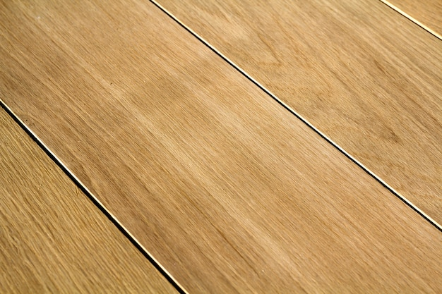 Натуральные светло-коричневые деревянные паркетные доски. солнечная мягкая желтая текстура.