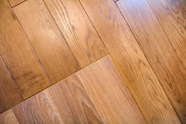 Natural light brown wooden parquet floor boards