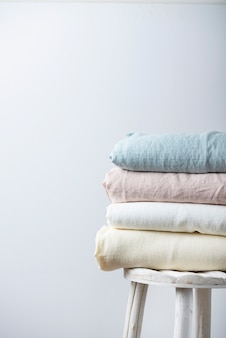 Natural linen fabrics in pastel colors in the light background. sewing concept