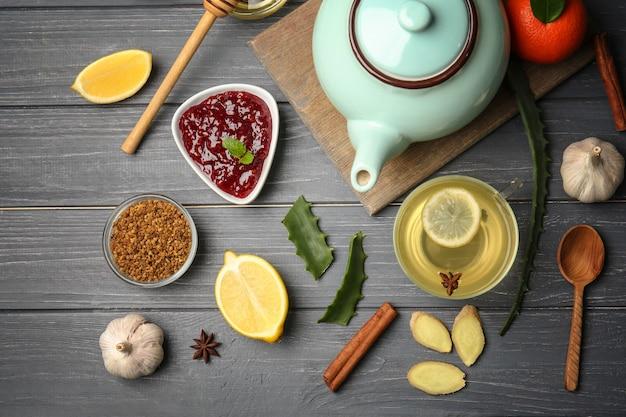 Natural medicine for cough on wooden background