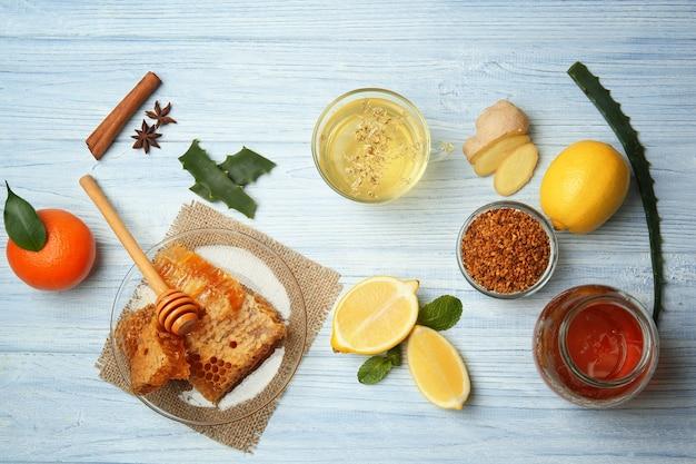 Natural medicine for flu on wooden background