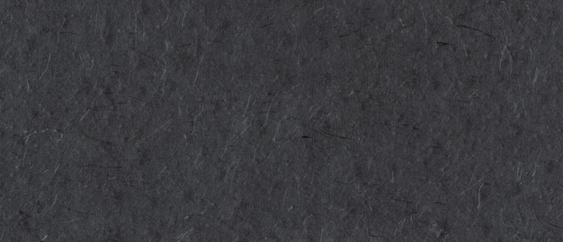 Natural nepalese recycled black paper texture background. horizontal banner