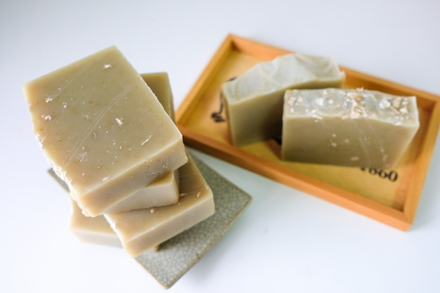 Natural oatmeal soap is placed on white