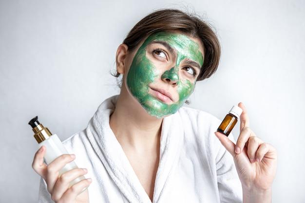 Natural oil and beauty care product in the hands of a young woman