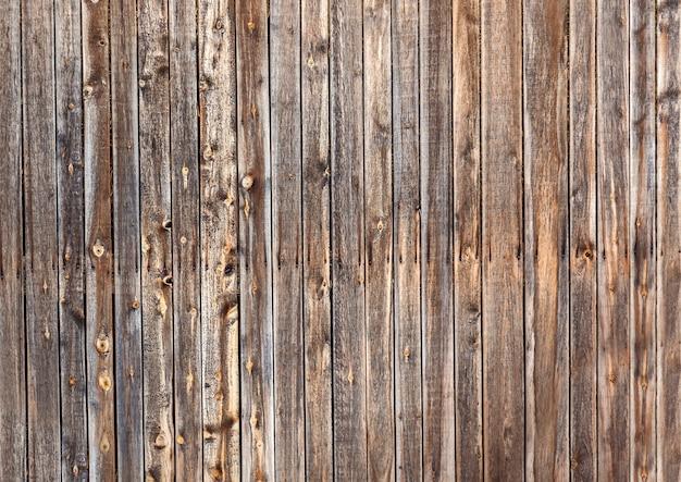 Natural old vintage weathered brown solid wooden fence