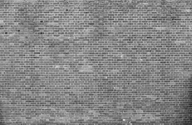 Natural old vintage weathered gray solid brick wall