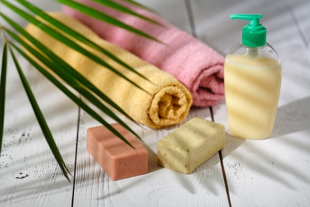 Natural organic bath products. towel, soap, shampoo bottle and leaves. beauty. mockup for design