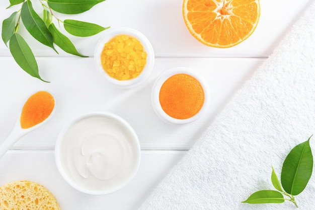 Natural organic beauty products with orange fruit.