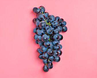 Natural organic black juicy grapes on a trend pink millennial background Country Village A