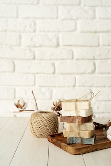 Natural organic cosmetics. stack of hand made soap on white wooden background