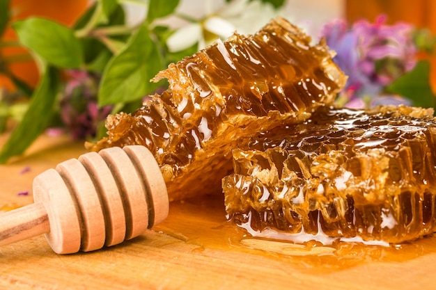 Natural organic honey  on a wooden table