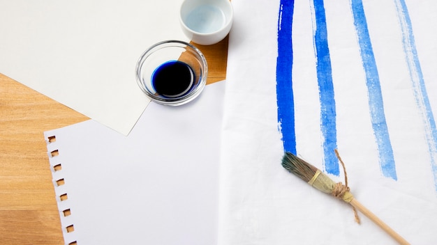 Natural paint brush and blue ink
