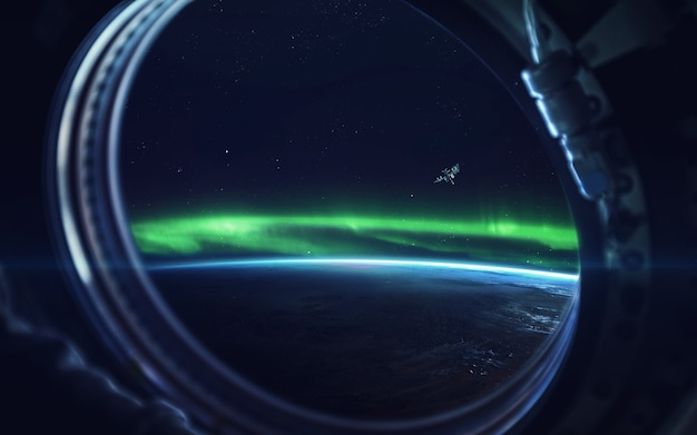 Natural phenomenon of northern lights (aurora borealis) related to the earth's magnetic field