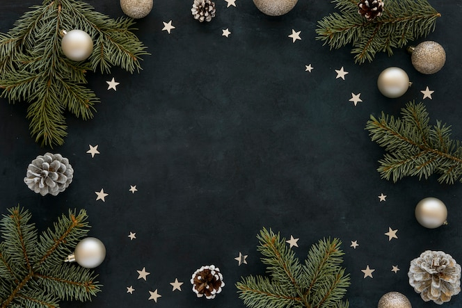 Natural pine needles and christmas globes on dark background