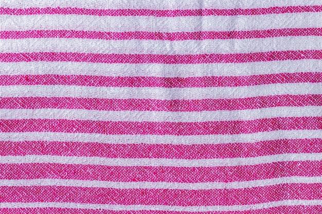 自然なピンクと白の縞模様の織物のテクスチャラフなテキスタイルの背景