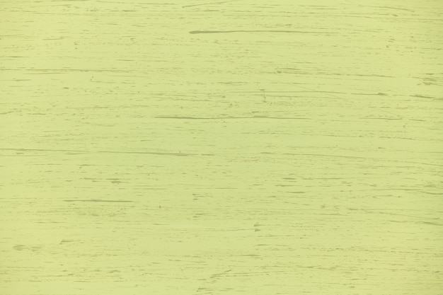 Natural plywood background painted yellow green solid color with brush strokes, new and clean