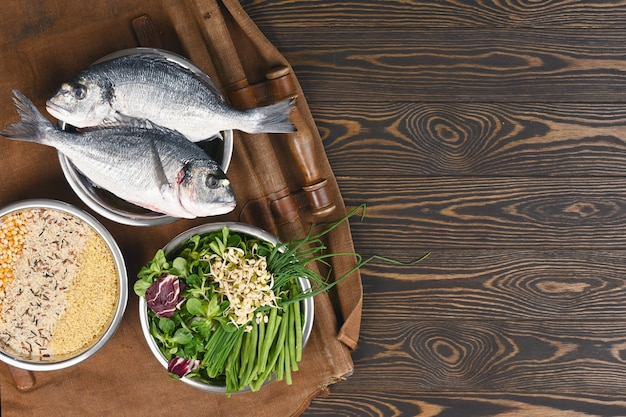 Natural raw ingredients for healthy pet food ingredients in individual bowls