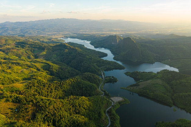 Natural reservoir dam in the valley in thailand aerial view from drone