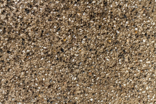 Natural rock pebbles concrete wall texture