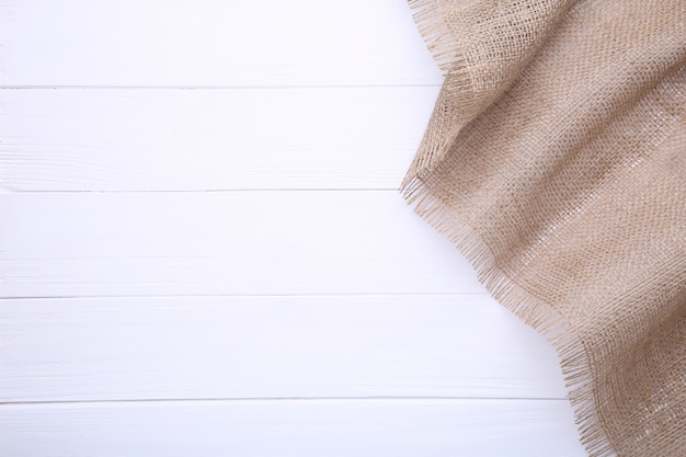 Natural sackcloth on white wooden, canvas on white wooden table