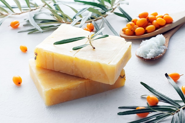 Natural sea buckthorn soap close-up on a white background.