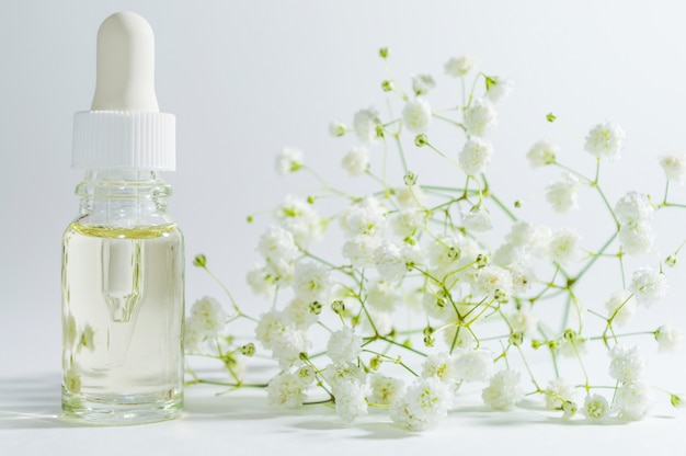 Natural serum in cosmetic bottle with dropper. organic spa cosmetics with herbal ingredients.
