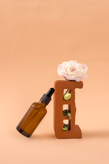 Natural skin care on a stone pedestal with an eustoma flower on a beige background