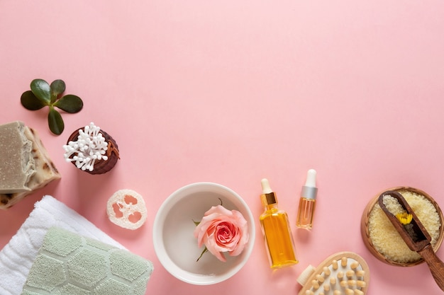 Natural skincare cosmetic products on pink pastel background.