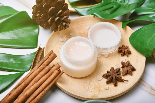 Natural skincare cream beauty product with spices oil, cosmetic bottle containers packaging with green nature leaves, blank label for organic spa branding mock-up, herbal healthy skin care.
