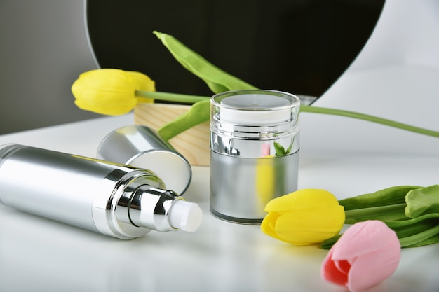 Natural skincare pump bottle, cosmetic bottle containers packaging with tulip flower essence, organic beauty product concept.