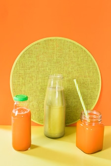 Natural smoothie in bottle and jar