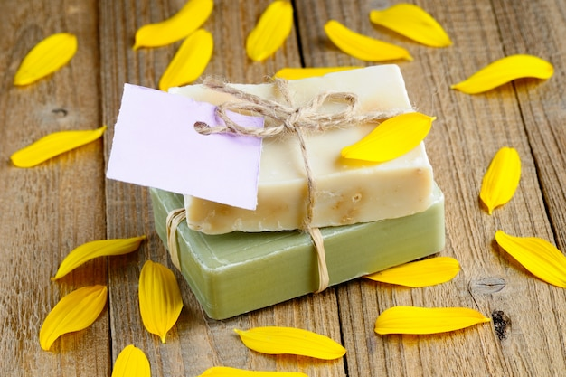 Natural soap bars with tag on wood
