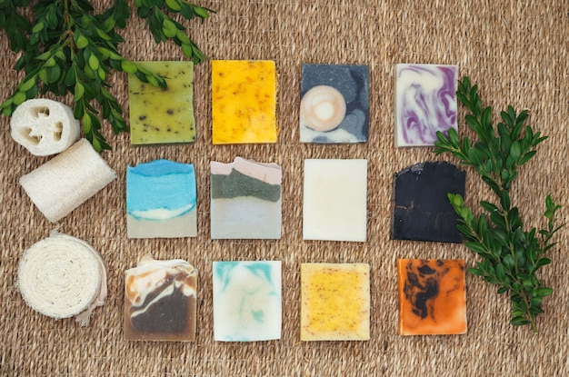 Natural soap with spa accessories. stacks homemade bars of soap with herbal material.