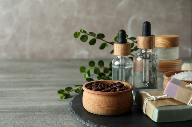 Natural spa cosmetics on gray textured table