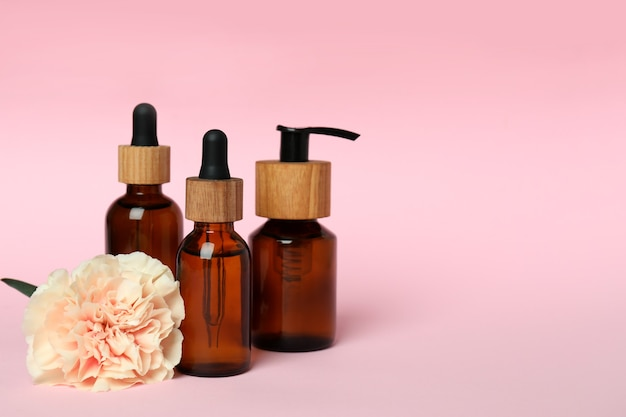 Natural spa cosmetics on pink background, space for text