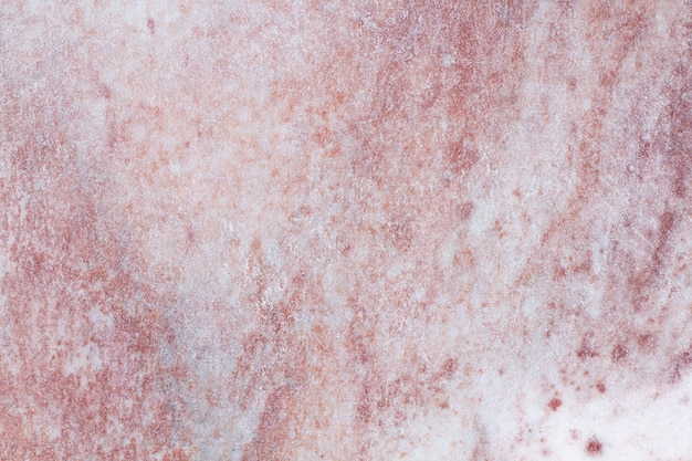 Natural stone background texture with pink and gray tones