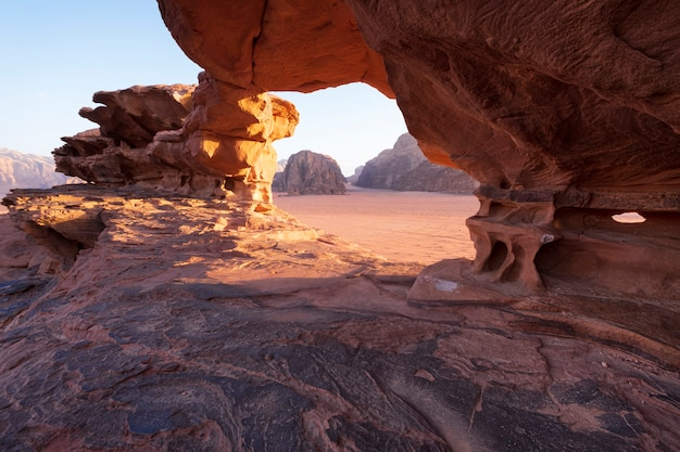 Natural stone bridge in the dry and hot desert of wadi rum jordan similar to mars