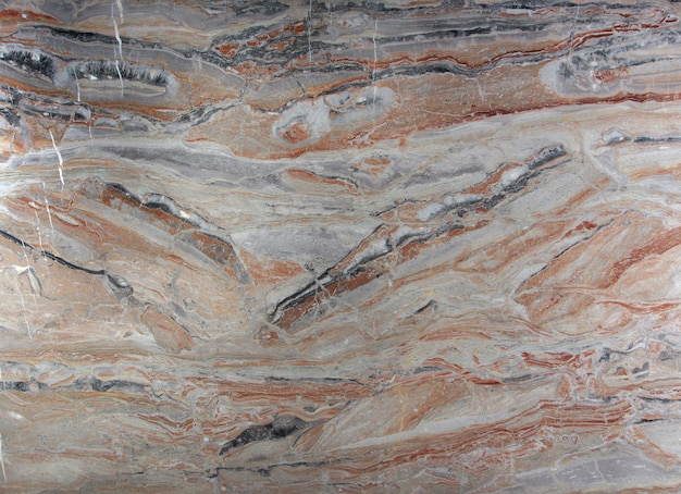 Natural stone marble pink with white, gray and red stains, called arabescato gold.