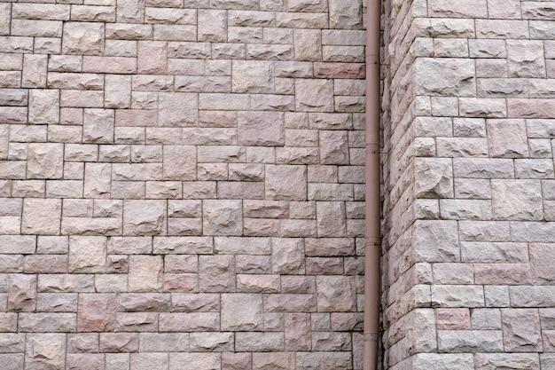 Текстура натуральной каменной стены для фона.