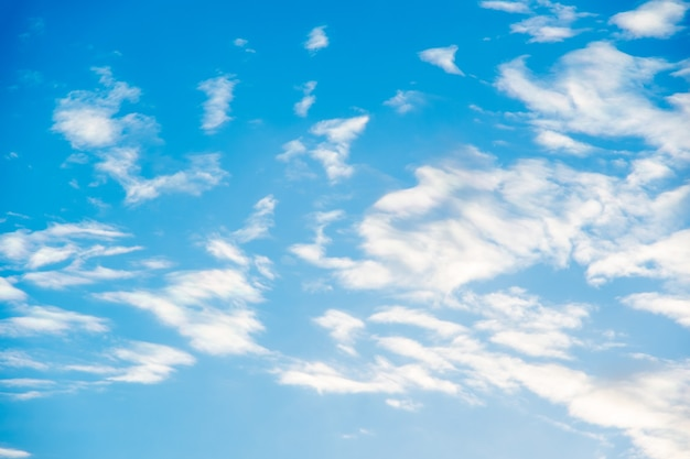 Natural sunny blue sky background with beautiful puffy white cumulus clouds and fluffy cirrus clouds