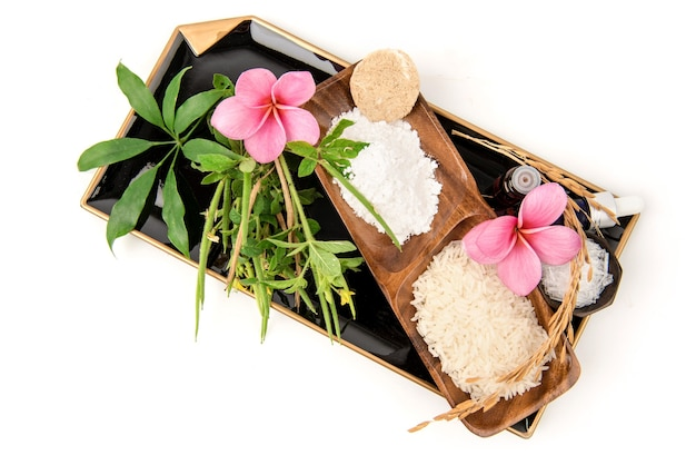Natural talc herbs such as cleome viscosa, jasmine rice, schefflera leucantha ,menthol and essential oil for spa skin treatment isolated on white .top view,flat lay.